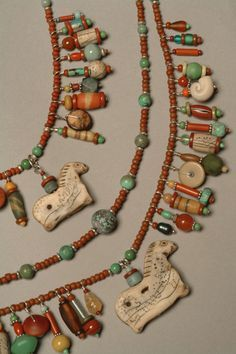 Luann Udell Shaman Necklace Polymer clay artifacts, turquoise, vintage and antique glass trade beads, vintage buttons.
