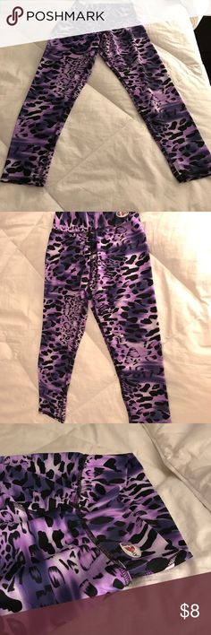 TEPUY Purple Cheetah workout Capri tights Worn only once. Super comfortable and form fitting. I was always skeptical about one size fits all tights but these hug your body and fits perfectly! Pants Leggings