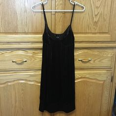 Dress A beautiful strapless dress or even could be worn has a night gown. Has a incredible soft touch. Has ribbon straps. Brand new. Dark brown GAP Dresses Strapless