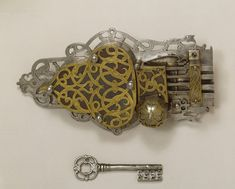 Lock and key, steel, blued with brass mounts, pierced, Germany, 1650-1700