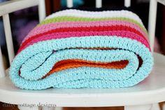 free crochet baby blanket pattern via Tangled Happy