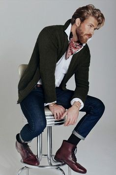 Wear a dark green shawl cardigan and navy jeans for a trendy and easy going look. Burgundy leather boots are a savvy choice to complete the look. Shop this look for $948: http://lookastic.com/men/looks/scarf-longsleeve-shirt-shawl-cardigan-belt-jeans-socks-boots/4283 — Burgundy Print Silk Scarf — White Longsleeve Shirt — Dark Green Shawl Cardigan — Dark Brown Leather Belt — Navy Jeans — Black Socks — Burgundy Leather Boots