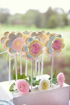 Cookies shaped like flowers on a stick. They look so cute, but how d you get it on the stick without it crumpling.