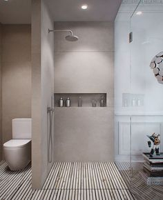 Modern bathroom with a beautiful floor. The shower has a space in wall for products, it is a good idea. #bathroomdecorideas #bathroomsets