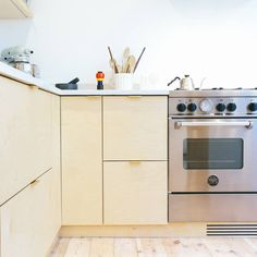 Birch plywood kitchen doors and drawers with brass edge pull handle by Plykea