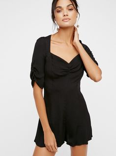 This Is What You Wanted Romper | Femme romper featuring ruched details at the sleeves and the bust. Semi-sheer fabrication. Hidden back zipper closure.