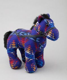 Never mind Black Beauty or Red Rum, this is a thoroughbred worth owning. The Pendleton Franklin Horse, equiped with reins, is ready for action. Features a bright Pendleton wool / cotton exterior and soft polyester fill. Pendleton say it's