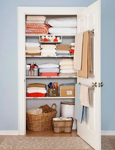 "still love this linen closet.just wish my linen ""closet"" was an actual closet with one door and not 3 separate cabinets.Use a towel rod on the inside of the linen closet for holding blankets. Home Staging, Linen Closet Organization, Organization Hacks, Closet Storage, Organizing Ideas, Organising, Bathroom Organization, Bathroom Storage, Bathroom Towels"