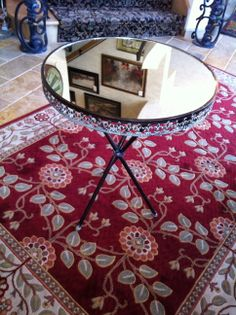 Who said mirrors are only on the wall. They also can make a great table top.