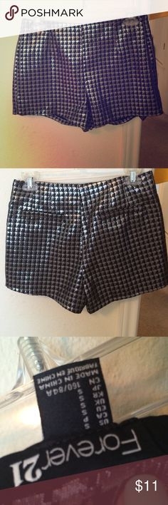 Shorts Silver and black pattern. Supper comfy with no harsh waste band. Soft material on the inside and very nice fitting for any size. Zipper on side. Shorts