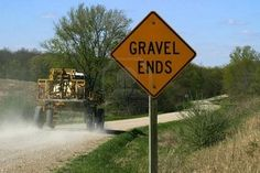 We live on a gravel road in rural Iowa. The gravel ends right past our driveway.