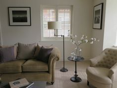Elegant sitting room #allwhite interior. Photographic prints by Paul Hart. Styling Sarah Crozier