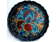 Rosemaling is now found in adult education programs and arts and crafts businesses all over the country. Description from rosemal.com. I searched for this on bing.com/images