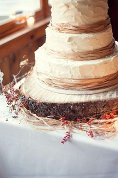Rustic Green Orange and Ivory Autumn Wedding | Confetti Daydreams - 3-tiered rustic wedding cake presented on the base of a tree stump ♥