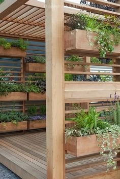 Covered Deck with windowbox container garden is a creative use of backyard space and landscaping idea for vertical space. Pergola!