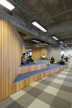 The Brazil headquarters for Walmart's online division by Estudio Guto Requena has colour coded levels and a miniature golf course on the roof. Commercial Interior Design, Office Interior Design, Commercial Interiors, Corporate Interiors, Office Interiors, School Architecture, Interior Architecture, Walmart, Tiered Seating
