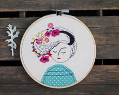 Embroidery Hoop Art, Embroidered Illustration of a Girl with Flowers#embroidery #embroideryhoopart #hoopart #embroideryillustration #illustration #textileart #bohoart #hipsterart #hipster #boho #modernembroiedery #homedecor #customembroidery #embroideryabstractportrait #portraits #kidroomdecor #abstractembroidery #abstractportrait #beard #flowersinbeard #flowersinhair #matryoshka