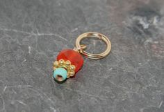 Tiny carnelian coin accented with gold by jewelrybybellagrace