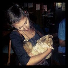 I probably wouldn't take my baby fox to a bar, but it looks like this woman's got it covered.