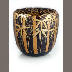 A lacquer natsume (tea container)  Meiji period (late 19th century)  Bearing a dark brown lacquer ground decorated with stalks of leafy bamboo in gold and slight-color takamakie and nashiji, the interior of black lacquer  2 5/8in (6.7cm) high