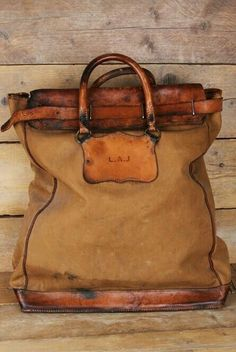 ~ Distressed canvas bag with leather accents.  Gorgeous. ~