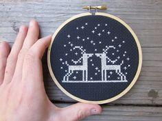 White on black cross stitch deer