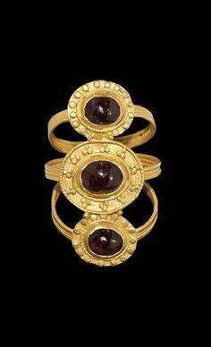 Pre-Viking Triple Bezel Gold Ring with Garnets - 3rd Century AD.
