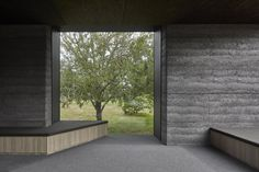 This moody Melbourne house extension by local studio Branch Studio Architects features dark rammed-charcoal walls, window nooks and an outdoor bathtub.