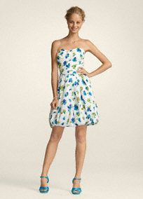 This fun and flirty floral print dress is the perfect pickfor the upcoming season.  Sweetheart strapless bodice is complemented by the fashion-forward bubble hem skirt.  Cotton pique fabric shapes a stunning silhouette while also providing dimension.  The floral print is a great choice for your maid of honor to stand out in your bridal party.  Fully lined. Back zip. Imported polyester. Dry clean only.  Available in a vibrant Malibu print.  Sizes and colors may have limited availability and…