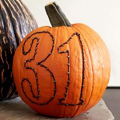 Outlined numbers make a fun, no-carve decoration idea for your pumpkins! Click through for more ways to decorate: http://www.bhg.com/halloween/pumpkin-carving/cool-halloween-pumpkins/?socsrc=bhgpin091214outlinednumberpumpkindesign&page=7