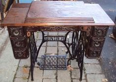 Antique 1925 Singer Treadle Sewing in Tiger Oak Cabinet. Has booklet and sewing feet in original box. Treadle Sewing Machines, Antique Sewing Machines, Solid Wood Cabinets, Sewing Cabinet, Refurbished Furniture, Baby Quilts, Cast Iron, New Baby Products, Singer