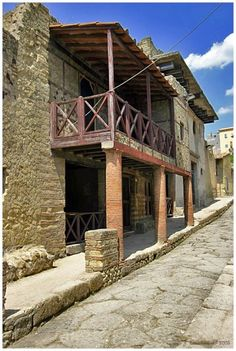 Herculaneum, Italy. The wood on this balcony was preserved by the lava and ash