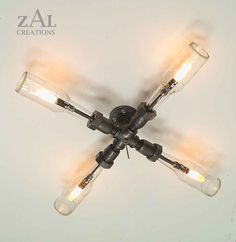 Wall Lamp. Beer bottles, Plumbing pipe & fittings. Wall light. Lighting Fixture. Ceiling lamp