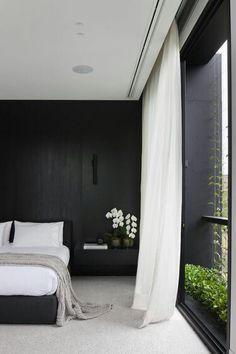 a Contratiempo black and white bedroom