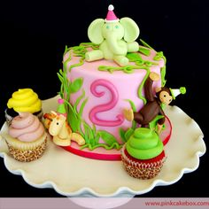 Girly Zoo themed cake! Love the cupcakes.