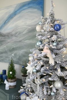 Snowy Spruce Flocked Christmas Tree with blue and silver ornaments
