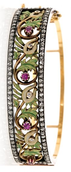 An Art Nouveau gold, silver, enamel and diamond and ruby bracelet, attributed to Lluis Masriera Rosés, circa 1905. #ArtNouveau #bracelet #Masriera