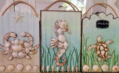 Seashell Crab - Original Coastal Collage - Handmade Beach Décor on Wood - 11 X 17 inches. This is the third in my sea life collages, the others are Seaturtle and Seahorse., see below. The process began with carving out the crab from canvas board. I then wrapped it in twine around the edges. I placed shells on the figure and filled in the gaps with pearl beads, The claws are fashioned from artificial capiz shells. The wood plank was painted a soft blue and sand was placed on the bottom. This…
