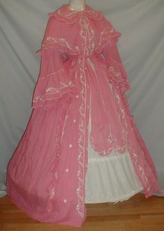 "Splendid 1860's Embroidered Pink Cotton Robe Museum de Accessioned | eBay seller fiddybee, all hand stitched & embroidered; double tieredd shawl styled collar, front opening trimmed w/ small crocheted balls, bodice partly lined with cotton, skirt unlined, no underarm discoloration; bust: 36""; waist is adjustable; length: 42"""