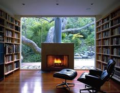 Various Home Library Design Pictures with Traditional Looks: Cool Modern Family Room Design Interior For Minimalist Home Library Design Pict. Traditional Fireplace, Modern Fireplace, Fireplace Design, Library Fireplace, Floating Fireplace, Concrete Fireplace, Fireplace Glass, Concrete Floors, Cozy Fireplace