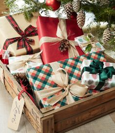 Marisa gives each guest a special delivery on Christmas morning by corralling gifts in tagged shipping crates under the tree.   - CountryLiving.com