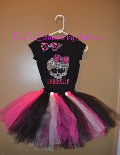 Monster high birthday outfit monster high    Made the skirt with a black and pink ribbon top and a monster high patch ironed on. Turned out pretty cute. It was too itchy for Adie so I made a slip lining for her.