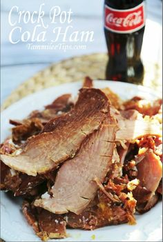Crock Pot Cola Ham! This ham is so easy to make and turns out amazing. The meat is so tender it falls right off the bone.