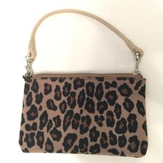 Nine West small clutch/wristlet Nine West small clutch/wristlet.  Adorable animal print.  Strap is attached to zipper.  Excellent condition! Nine West Bags Clutches & Wristlets