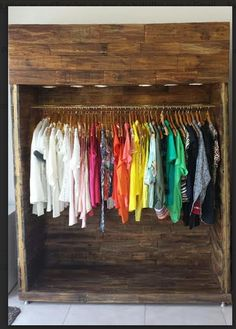 Clothes Cabinet made with metal structure and covered with pallets and with built-in light ...…