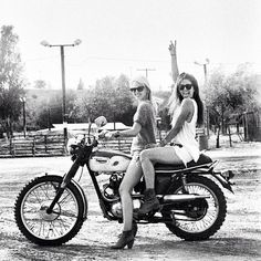 2 girls on an old Triumph Motorcycle