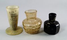 A Sasanian Moulded Black Glass Bottle, Tapering Neck