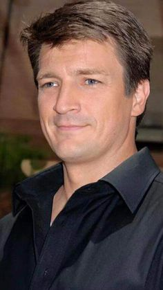 , blue eyes and in black. Nathan Fillion, Bob Marley, Castle Tv, Firefly Serenity, Hallmark Movies, Actor Model, Best Shows Ever, Blue Eyes, Brown Hair