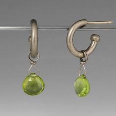 Iconic and interchangeable, Reinstein/Ross drops are an effortless way to personalize your jewelry. A pair of 18K white gold, faceted peridot hatchet drops. Wear them alone, or mix them with other Reinstein/Ross gemstone drops to create a layered look!