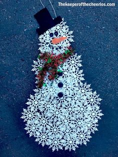 Dollar Store Snowflake Snowman Materials: Dollar store snowflake ornaments about 4-5 boxes (up to 30 snowflakes used- depends on the size of snowflakes and how large you desire your snowman to be) Garland Buttons Orange felt Black felt String or ribbon to hang from Hot glue and glue gun Scissors Directions Lay out your snowflakes into 3 different size round shapes (small, medium and large) Glue all of your snowflakes together in your 3 round shapes Stack and glue your 3 round snowflake…